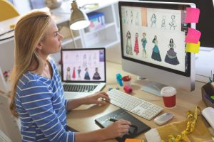 female fashion designer using graphic tablet while D25EN46 300x200 - female-fashion-designer-using-graphic-tablet-while-D25EN46.jpg