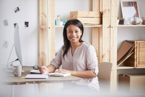 smiling mixed race woman at desk PY2ZLH6 300x200 - smiling-mixed-race-woman-at-desk-PY2ZLH6.jpg